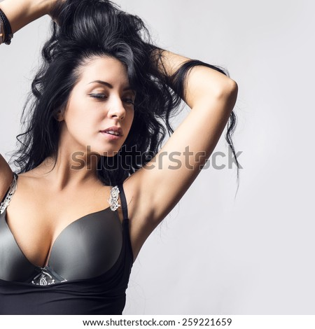 fashion studio photo of beautiful young girl with dark hair  - stock photo