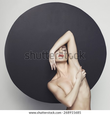Fashion studio photo of nude elegant lady in giant black hat. Health and beauty - stock photo