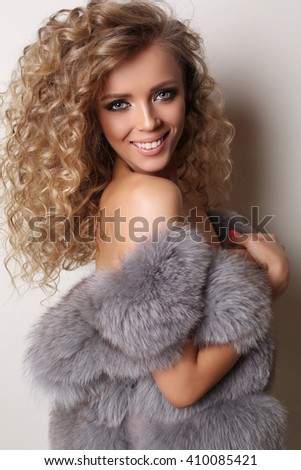 fashion studio photo of sexy beautiful woman with blond curly hair wears elegant lingerie - stock photo