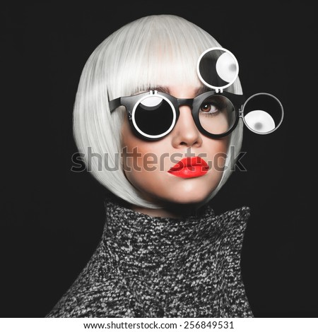 Fashion studio photo of stylish lady in sunglasses - stock photo