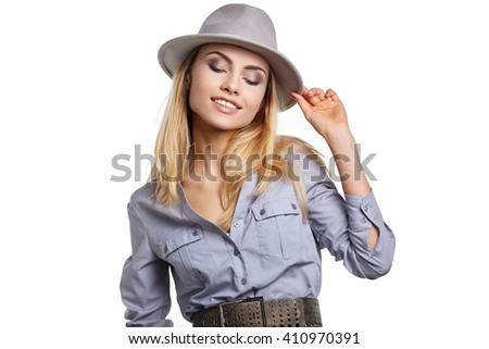 fashion studio portrait of beautiful sensual woman with blond hair with evening makeup with hat - stock photo
