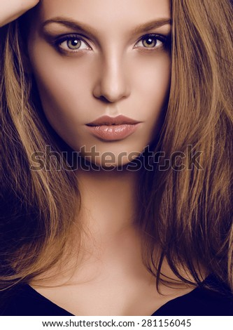 fashion studio portrait of beautiful young woman with dark hair and green eyes - stock photo