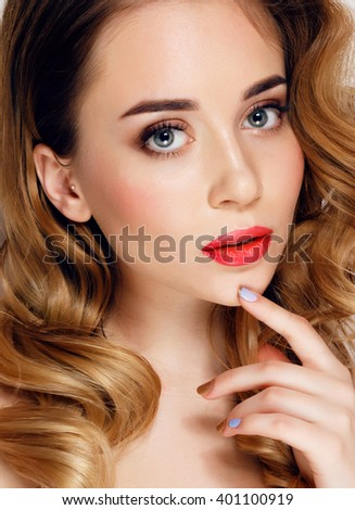 fashion studio portrait of beautiful young woman with elegant hairstyle