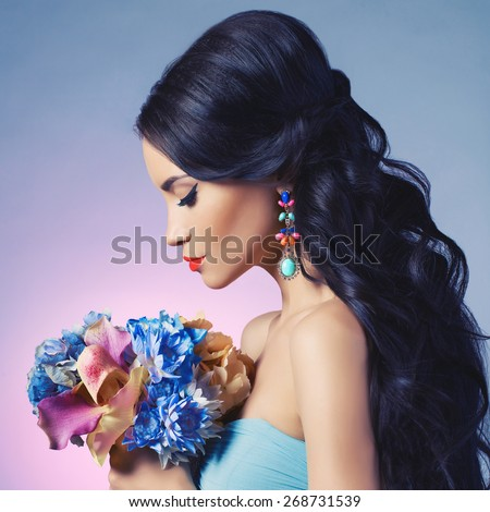 Fashion studio portrait of beautiful young woman with flowers. Jewelry and accessories - stock photo