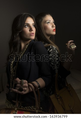 Fashion studio portrait of two beautiful girls