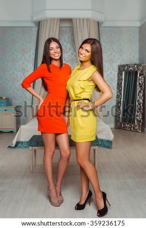 Fashion Studio Portrait of two Beautiful Stylish Glamour Womans at Room - stock photo