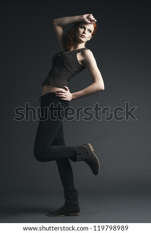 Fashion studio portrait of young woman