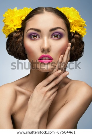 fashion studio shot of beautiful elegant woman with bright make-up and hairstyle - stock photo