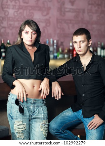 Fashion style photo of a couple in the bar