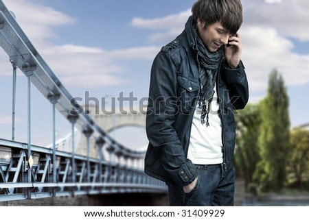 Fashion style photo of a man talking over cellphone - stock photo