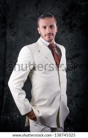 Fashion style photo of a man wearing white suit - stock photo