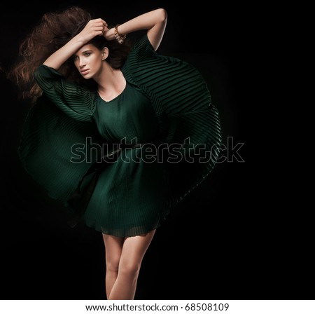 Fashion style photo of a young brunette - stock photo