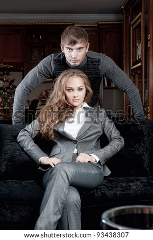 Fashion style photo of an attractive young couple inside luxury apartment - stock photo