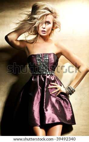 Fashion style photo of beautiful blond lady - stock photo