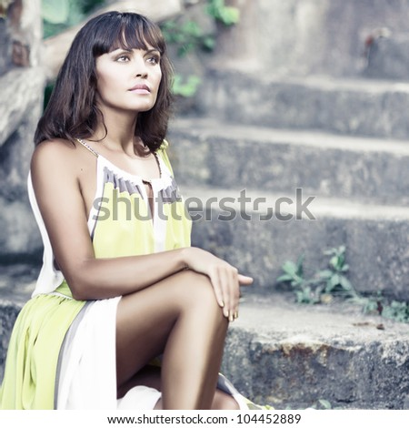 Fashion style photo of beautiful woman outdoor - stock photo