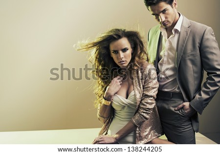 Fashion style photo of sexy couple - stock photo