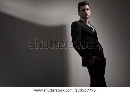 Fashion style photo of young man - stock photo