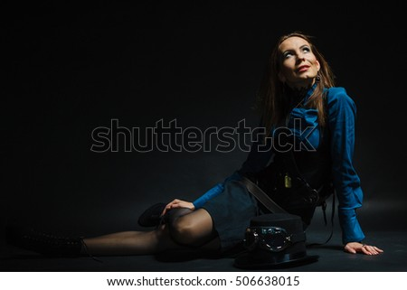 Fashion subculture antique concept. Retro lady sitting. Young female dressed in victorian style clothing on the floor.