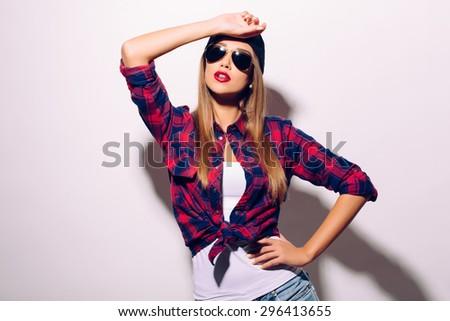 Fashion swag girl in sunglasses - stock photo