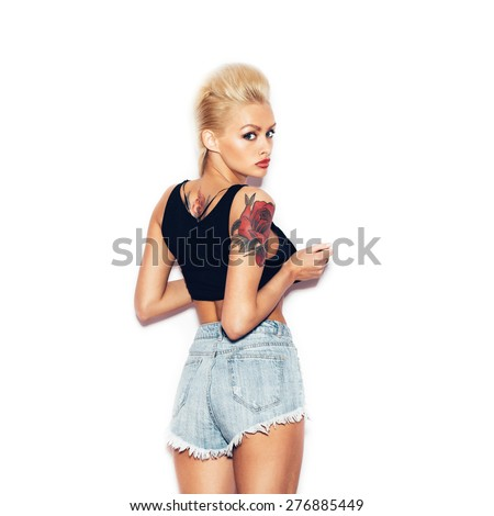 Fashion swag sexy blonde young girl posing and looking at camera.  White background, not isolated - stock photo