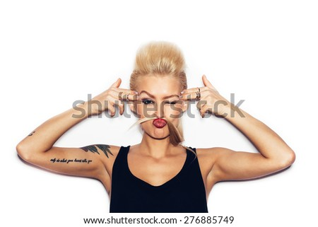 Fashion swag sexy blonde young woman gun shows. Girl having fun. White background, not isolated - stock photo