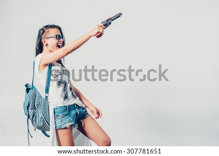 Fashion swag sexy girl holding gun woman having fun  hooligan, rebel - stock photo