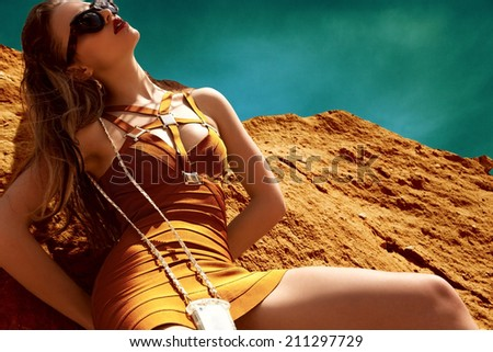 Fashion tanned woman - stock photo