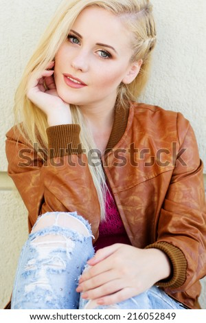 Fashion teenager girl is wearing autumn stylish clothes