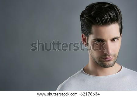 Fashion trendy young man silver futuristic  portrait over gray - stock photo