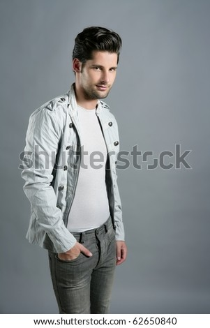 Fashion trendy young man silver  portrait over gray - stock photo