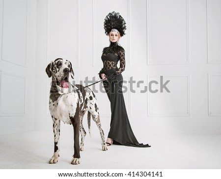 Fashion type photo of a young woman with big dog - stock photo