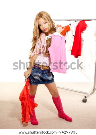 fashion victim girl at backstage wardrobe choosing clothes - stock photo