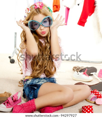 fashion victim kid girl wardrobe messy playing with sunglasses - stock photo