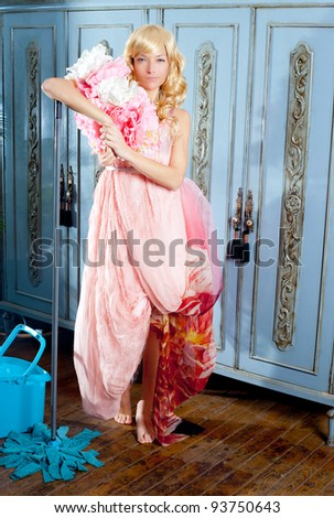 fashion vintage blond housewife with mop cleaning chores at home - stock photo