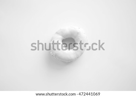 Fashion white donut on white background. Sweet donut. Donut background. Toned image.