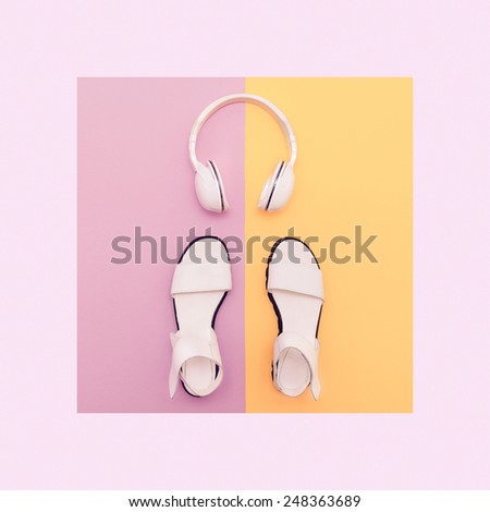 Fashion white Sandals and Headphones on vanilla background. Urban Summer time - stock photo