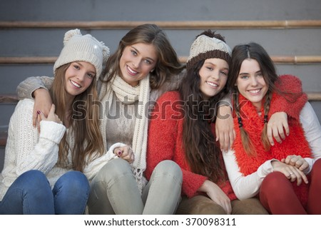 fashion winter teens with beautiful smiles and teeth - stock photo