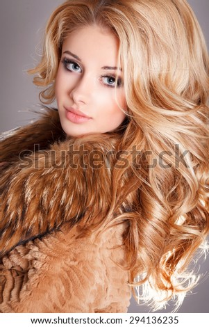 Fashion woman Beauty girl model blonde long curly hair and bright makeup, sexy blond vogue style female, beauty and jewelry model vogue style, young woman in luxury fur coat, studio isolated, series - stock photo
