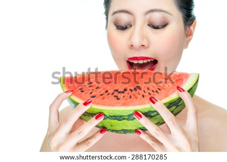 Fashion woman enjoy eating watermelon with red lips, yummy, bite - stock photo