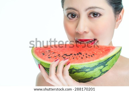 Fashion woman enjoy eating watermelon with red lips, yummy, holding - stock photo