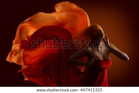 Fashion Woman Fabric on Face, Dance Silk Cloth Waving On Wind - stock photo