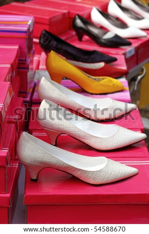 fashion woman heel shoes shop in a row over pink boxes