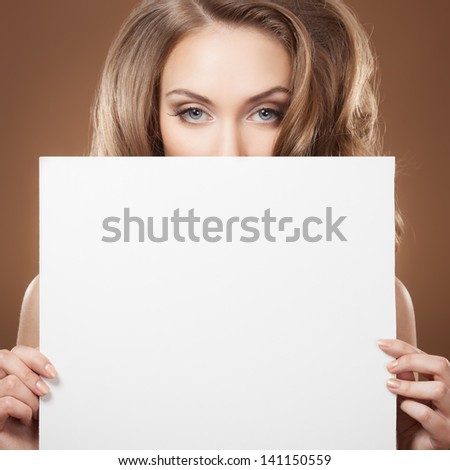 Fashion Woman Holding Empty Billboard In Hands - stock photo