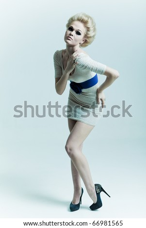 Fashion woman in a dress and shoes - stock photo