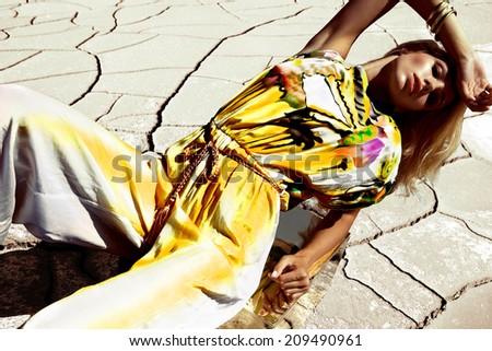 Fashion woman in desert - stock photo