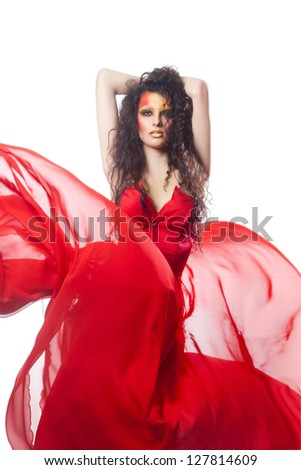 Fashion woman in  dress waving flying on wind flow