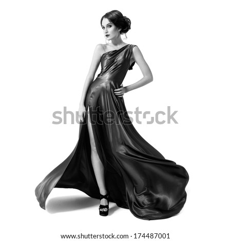 Fashion woman in fluttering dress. Black and white image. Isolated on white background.  - stock photo