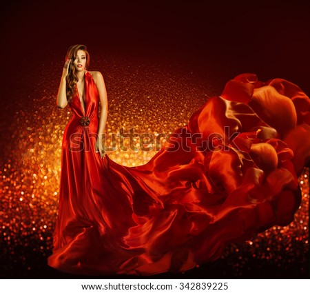 Fashion Woman in Red Dress, Beauty Model Gown Flying Silk Fabric, Elegant Girl with Flowing Cloth - stock photo