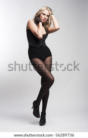 fashion woman in stockings, waistcoat and gloves
