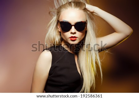 fashion woman in sunglasses, studio shot. Professional makeup and hairstyle